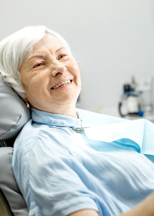 Older woman smiling, waiting for advanced dental implant procedures in Carmichael, CA