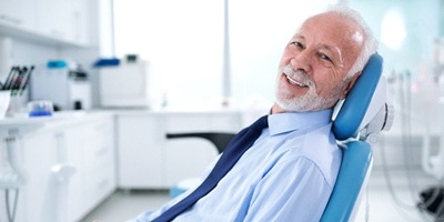 Smiling man in dentist's chair